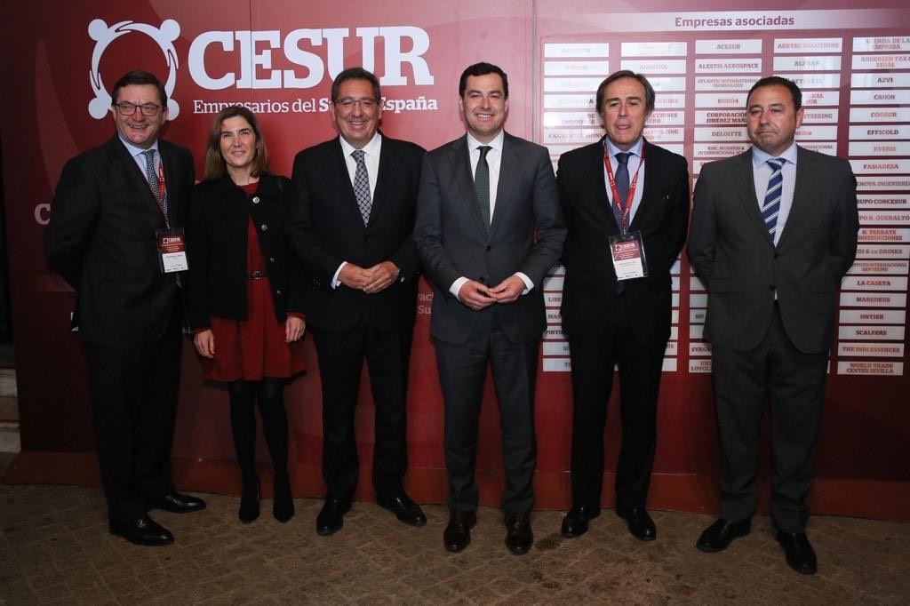 Juan Manuel Moreno Bonilla y Antonio Pulido en la jornada sobre ciberseguridad en la empresa